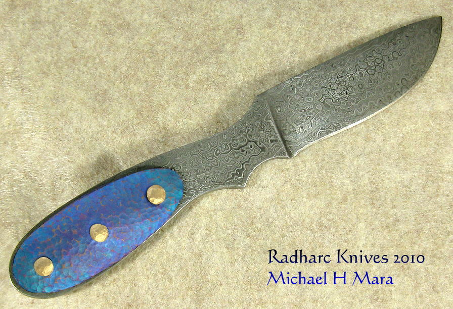Damascus and anodized Niobium hunting knife
